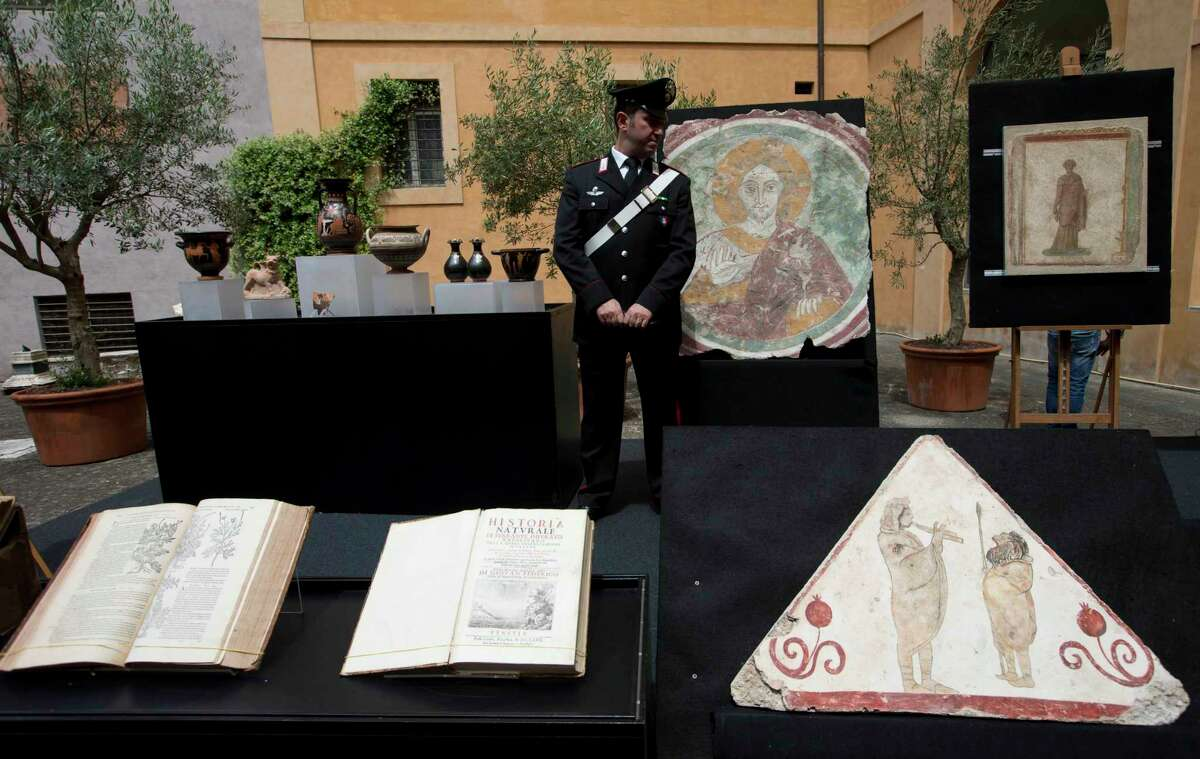 A Carabinieri Italian paramilitary police officer stands next to ancient artifacts returned to Italy by The United States, on display in a Rome Carabinieri barracks Tuesday.