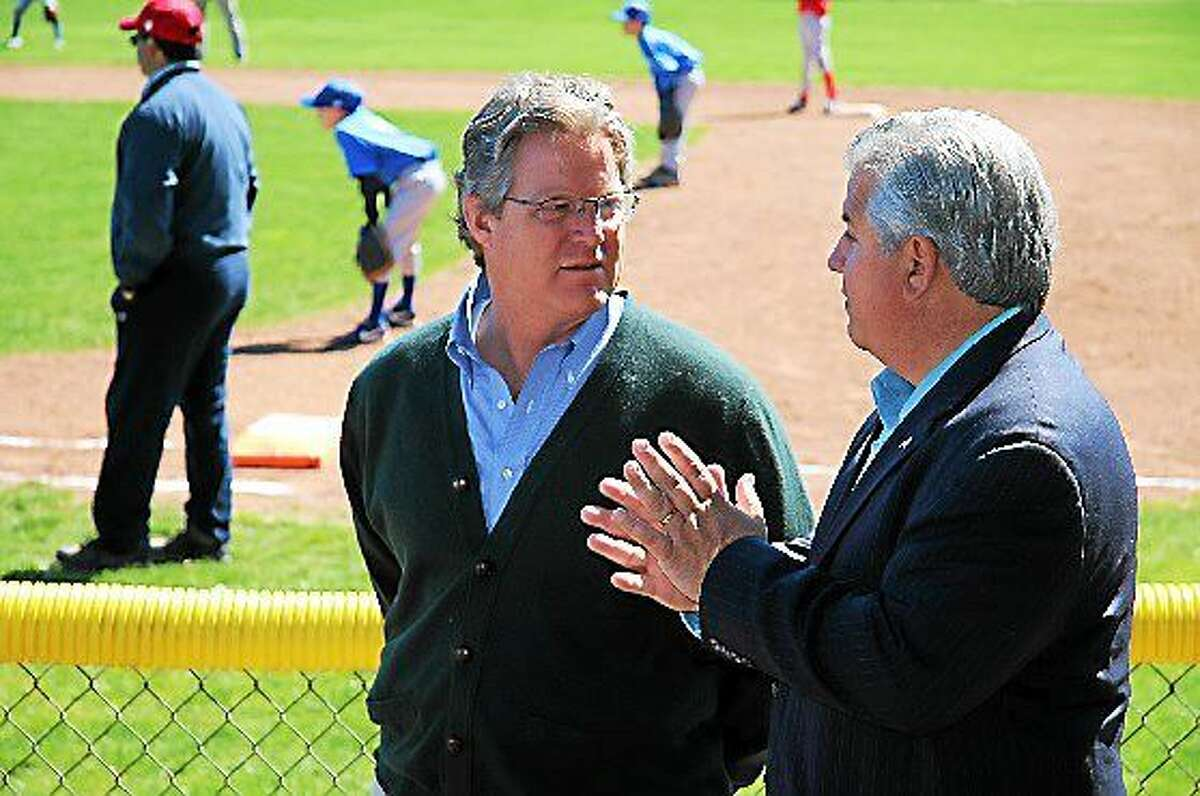 Senator Ted Kennedy Jr. talks with Branford's Director of Recreation Alex Palluzzi. Palluzzi has not used dangerous pesticides on public playgrounds and fields for over 20 years and Kennedy wants all Connecticut communities to follow the same standard.