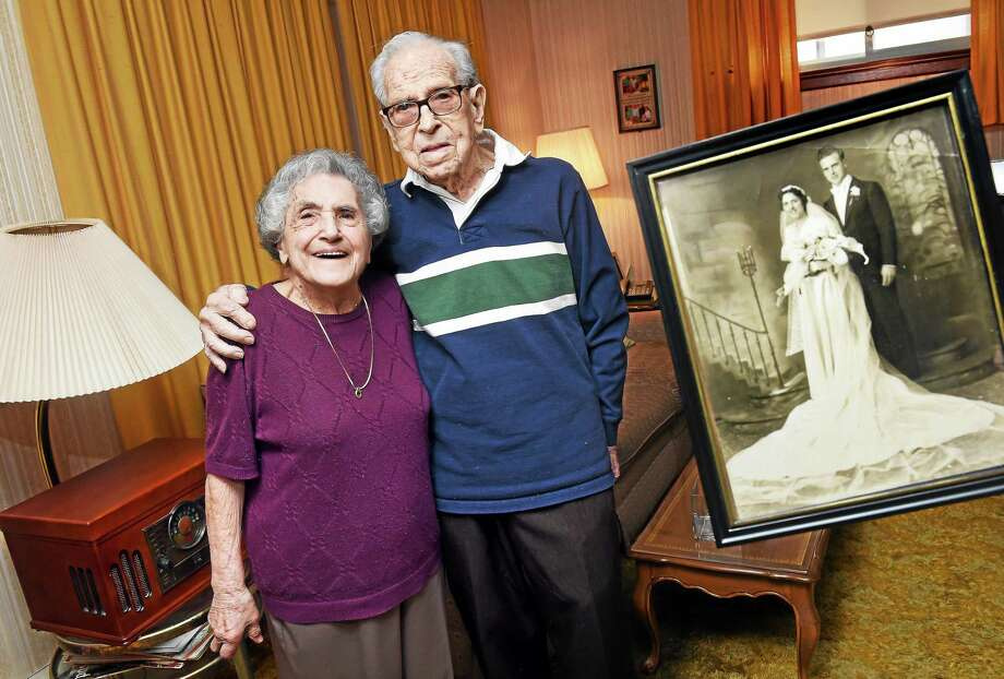 Evelyn and Lou DeAndrus in their home in Hamden on 4/24/2015 with their wedding portrait of 77 years ago. Photo: Arnold Gold-New Haven Register