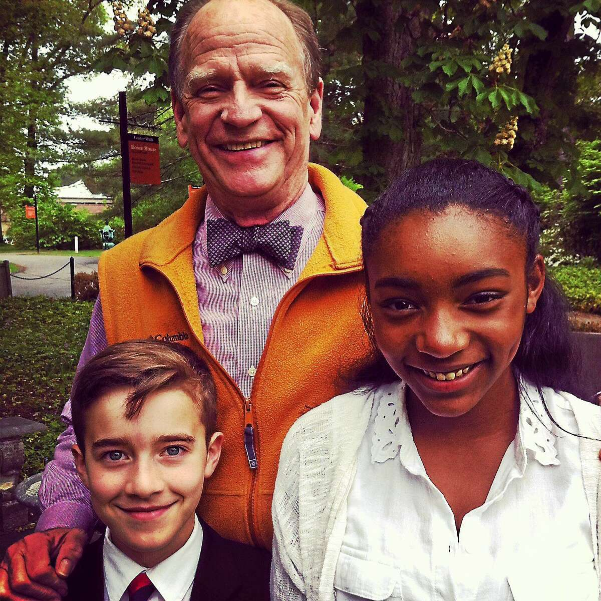 Livingston Taylor with two members of the Trinity choir.