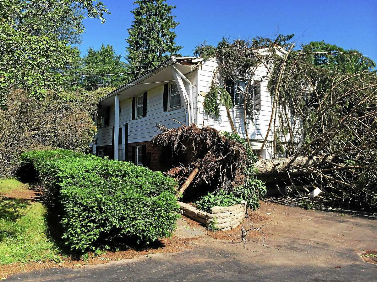 A home on Todd Drive South in North Haven had visible exterior damage Wednesday morning. Strong storms swept through town Tuesday, including a microburst near Todd Drive South that took down many trees in the neighborhood.