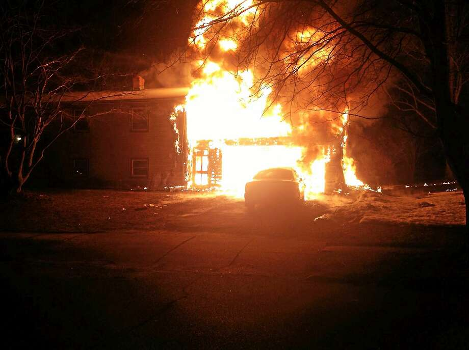 Milford firefighters battled flames in a garage on Ardmore Road as the fire spread to the house. Firefighters kept it from spreading but there was heavy smoke and heat damage. Photo: (Photo Courtesy Of The Milford Fire Department)
