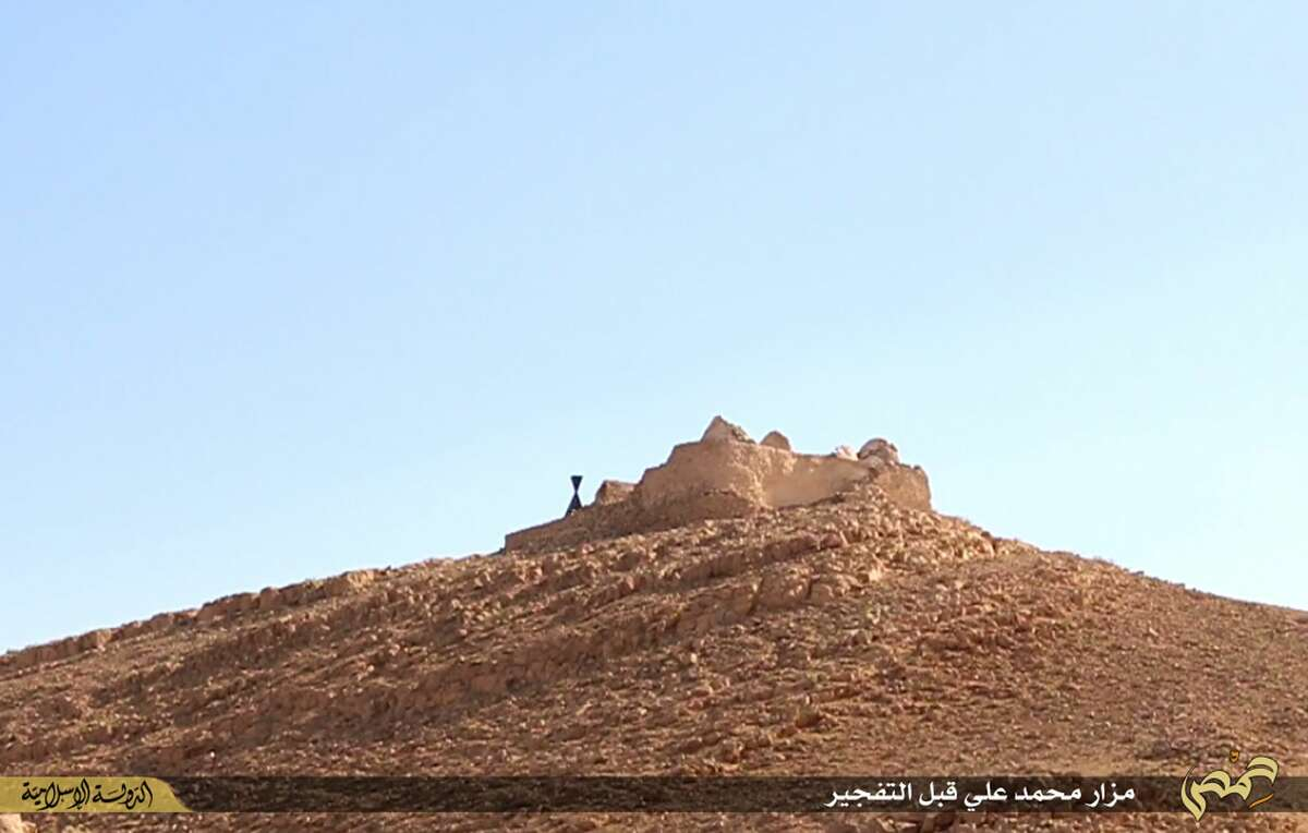 This undated photo released on June 22, 2015, by a militant website, which has been verified and is consistent with other AP reporting, shows the tomb of Mohammad Bin Ali before being blown up by Islamic State militants, in the historic central town of Palmyra, Syria. A Syrian official says the Islamic State group has destroyed two mausoleums in the historic central town of Palmyra. Maamoun Abdulkarim, the head of the Antiquities and Museums Department in Damascus, tells The Associated Press that one of the tombs belongs to Mohammad Bin Ali, a descendant of Islamís Prophet Muhammadís cousin Imam Ali. (The website of Islamic State militants via AP)