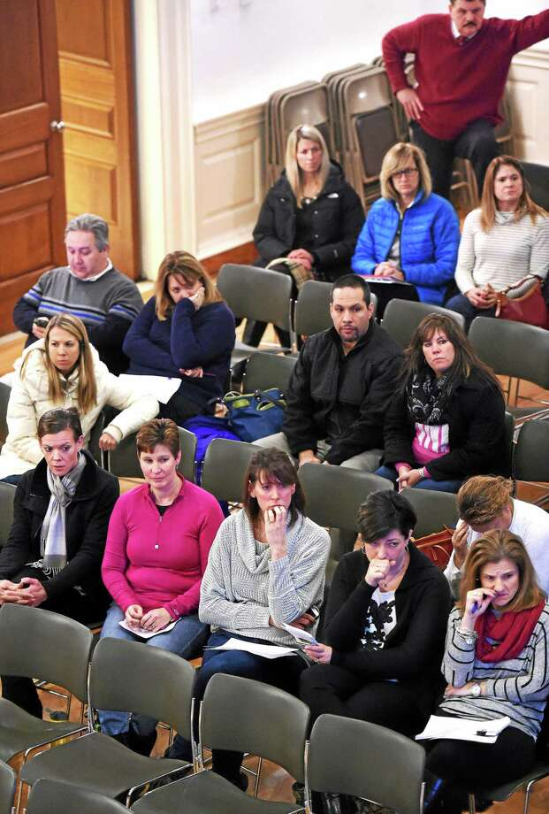 Parents attend a Board of Education meeting about redistricting at City Hall in Milford Monday. Photo: Arnold Gold — New Haven Register