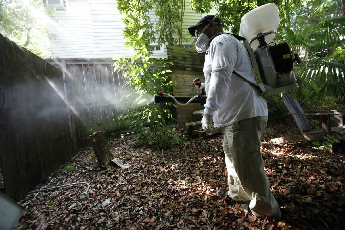 In this Oct. 4, 2012 photo, Jason Garcia, a field inspector with the Florida Keys Mosquito Control District, tests a sprayer that could be used in the future to spray pesticides to control mosquitos in Key West, Fla.
