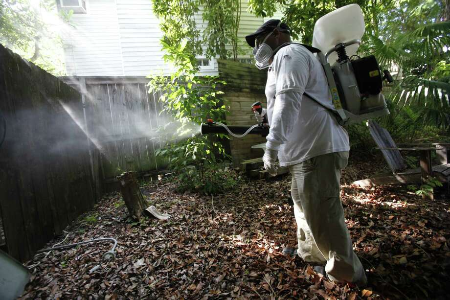 In this Oct. 4, 2012 photo, Jason Garcia, a field inspector with the Florida Keys Mosquito Control District, tests a sprayer that could be used in the future to spray pesticides to control mosquitos in Key West, Fla. Photo: AP Photo/Wilfredo Lee, File   / AP