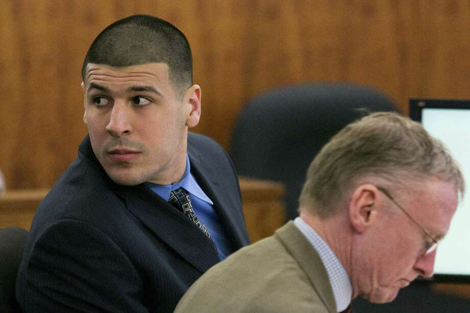 Aaron Hernandez looks over his shoulder during his murder trial Monday at Bristol County Superior Court in Fall River, Mass. Photo: Dominick Reuter — Boston Herald   / Pool Boston Herald