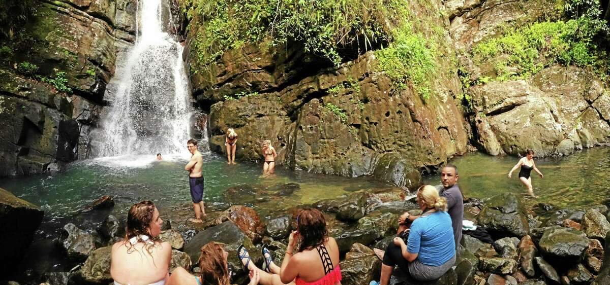 A pleasant waterfall basin awaits at the end of a hike in El Yunque National Forest.