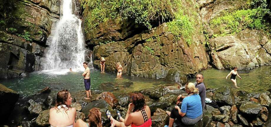 A pleasant waterfall basin awaits at the end of a hike in El Yunque National Forest. Photo: Journal Register Co.