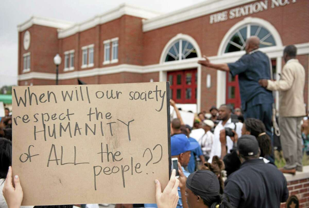 Protesters rally Aug. 10, 2014 to protest the shooting of Michael Brown, 18, by police in Ferguson, Mo.