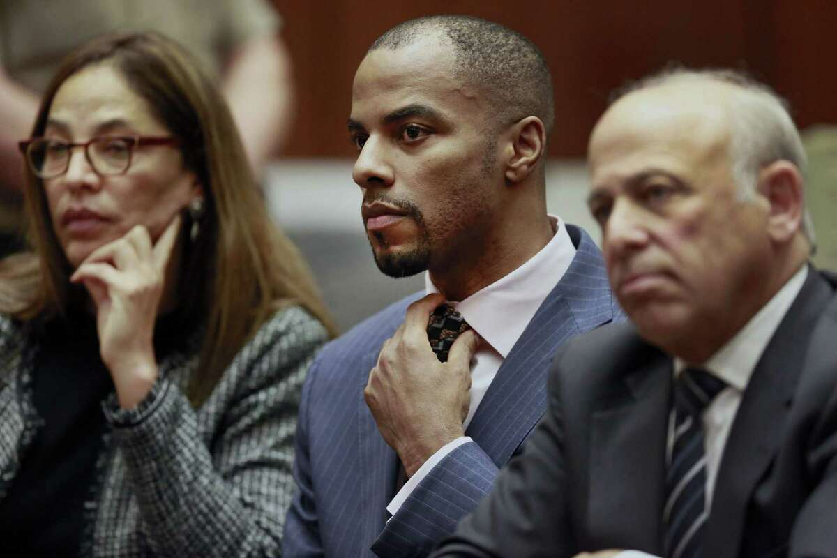 Former NFL safety Darren Sharper, center, with his attorneys, Lisa Wayne, left, and Leonard Levine, appear in Los Angeles Superior Court on Monday.