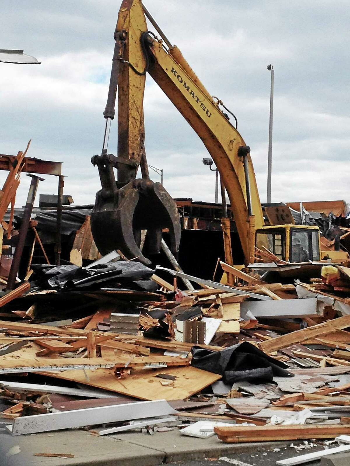 The former American Steakhouse at 354 Sawmill Road is demolished Friday in West Haven.