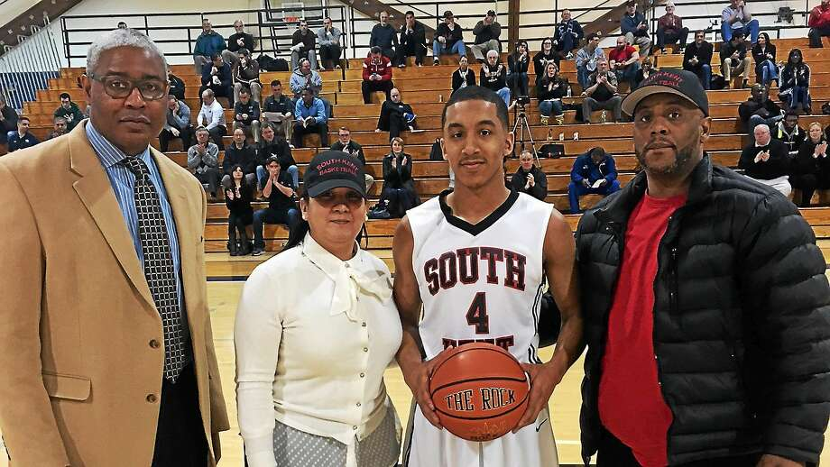 Tremont Waters, second from right, poses with, from left, South Kent coach Kelvin Jefferson, his mother, Vanessa, and father, Ed, before a recent South Kent Prep game. Photo: CONTRIBUTED PHOTO
