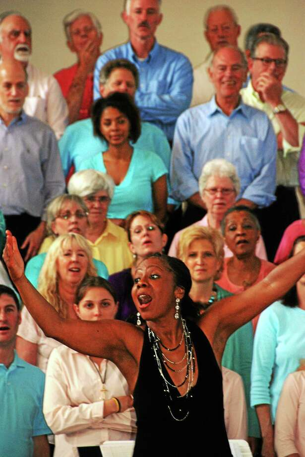 ìMusic at the Meetinghouseî is excited to announce the dates for another uplifting  ìShoreline Soulî Community Choral Gospel Workshop at the First Congregational Church (on the town green) directed by the shorelineís own, Angela Clemmons.  All levels are welcome to participate.  The five 2-hour workshop sessions will culminate in a hand-clapping, foot-stomping, this-couldnít-possibly-be-Madison, CT concert, where the participants will perform the traditional and contemporary gospel songs theyíve learned.    ìOur weekly sessions are upbeat, fun and very user-friendly,î Angela says.  ìNo one needs to know how to read music.  All songs are taught by ear and everyone is given a practice CD.  Because itís all about the music and not a church service, we get singers from all faiths and even the faith-less.  It works well.  Itís amazing how much the choir learns and how confident they become in five short weeks, particularly when many have never sung gospel before.î    There will be five Monday sessions, April 27, May 4, 11, 18, (skip Memorial Day), resume June 1, from 6:45-8:45 PM, at the First Congregational Church (on the town green), 26 Meetinghouse Lane, Madison, CT.  The concert, which is free and open to the public will be Sunday, June 7 at 3:00 PM, with a pre-concert rehearsal at 1:30 PM.    The workshop registration fee is $90.00.  If PAID by April 13, the early registration fee is $80.00.  You may begin your registration by phone: 203-619-1415 or e-mail: shorelinesoul@comcast.net.  Registration is only complete after payment has been received.  Some scholarships are available.  Although the workshop is primarily for adults, youth who are able to follow a lyric sheet are welcome to participate. Photo: Journal Register Co.