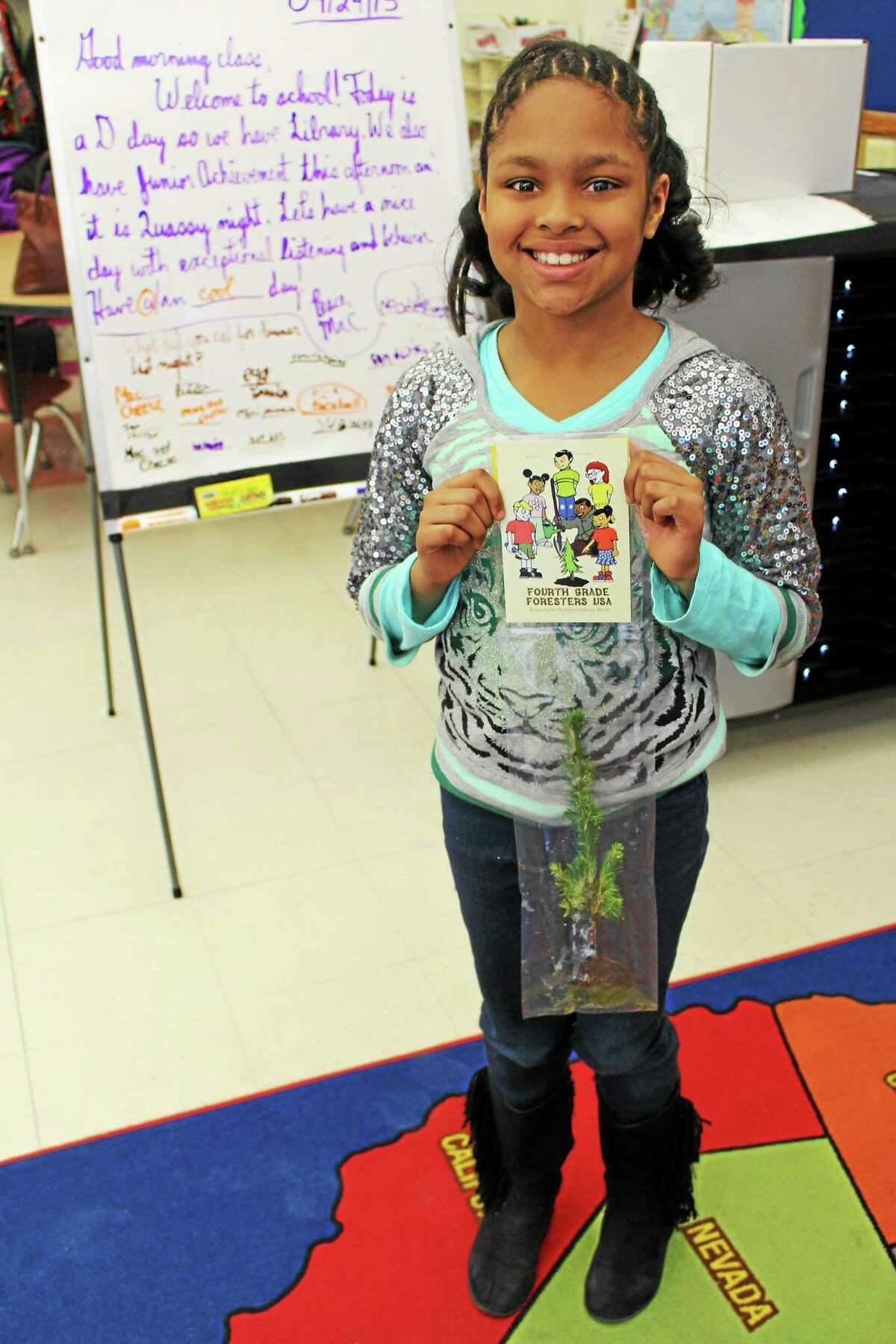 Student Jada Diaz with her pine tree sapling.