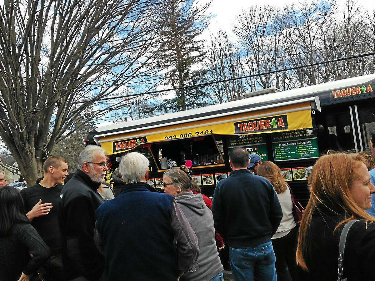 People line up for Taqueria Cinco during Food Truck Appreciation Day in Madison Friday.