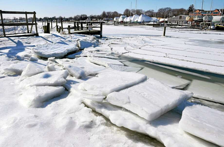 Continuous cold temperatures have partially frozen a portion of Milford Harbor on 2/20/2015. Photo: Arnold Gold--New Haven Register