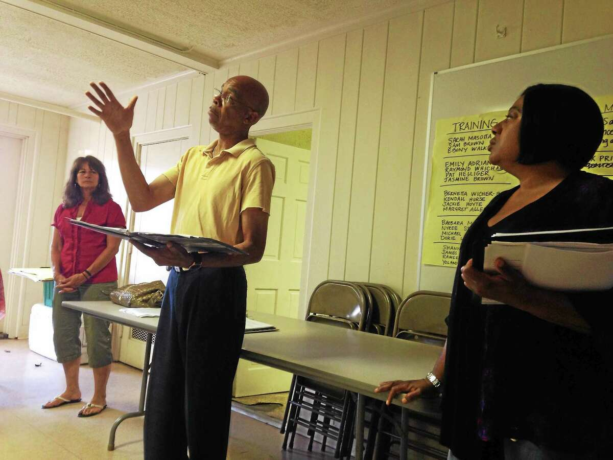Kendall Hurse, center, speaks about the lunch counter sit-ins in the south in the 1960s that led to the passage of the Civil Rights Act during a Kingian Nonviolence Training session Wednesday, June 24, 2015. On his left is Margaret Allande and on his right is New Haven police officer Jackie Hoyte.