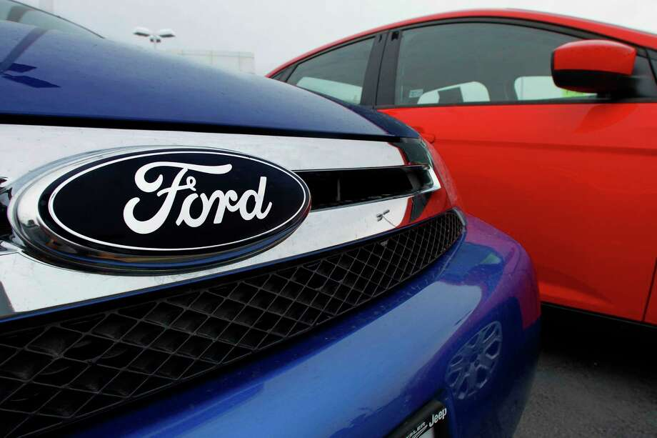 FILE - This July 1, 2012 file photo shows the Ford logo on a vehicle at a Ford dealership in Springfield, Ill. Under a new ride-sharing program announced Tuesday, June 23, 2015, customers who finance their vehicles through Ford Motor Credit will be able to rent their vehicle to pre-screened drivers for short-term use, helping to defray some monthly vehicle ownership costs. Photo: AP Photo/Seth Perlman, File / AP