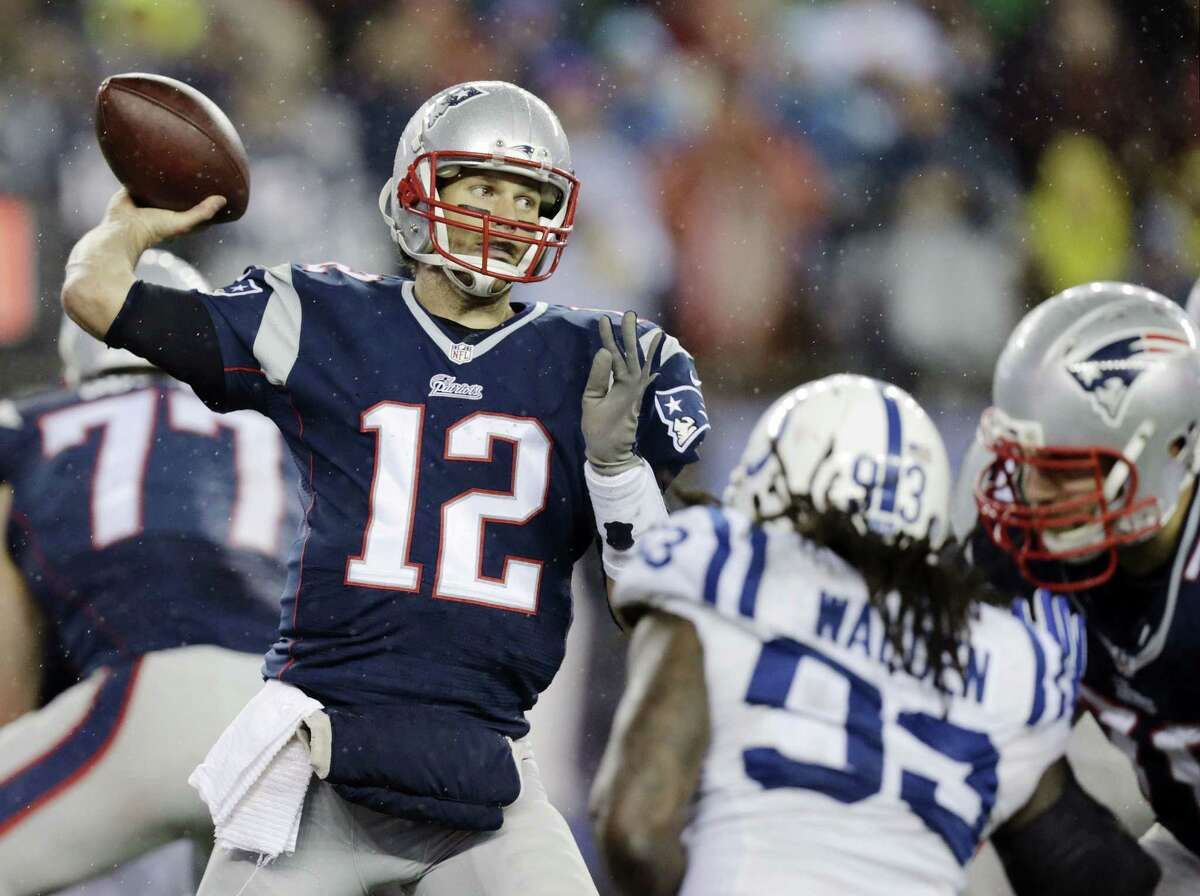 """Dozens of New England Patriots fans filled a parking lot at Gillette Stadium to protest the four-game suspension handed to quarterback Tom Brady over the """"Deflategate"""" scandal."""