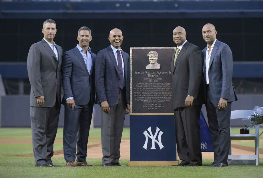 From left, New York Yankees' Andy Pettitte, Jorge Posada, Mariano Rivera, Bernie Williams and Derek Jeter pose by Williams' plaque before Sunday's game at Yankee Stadium in New York. Photo: Bill Kostroun — The Associated Press   / FR51951 AP