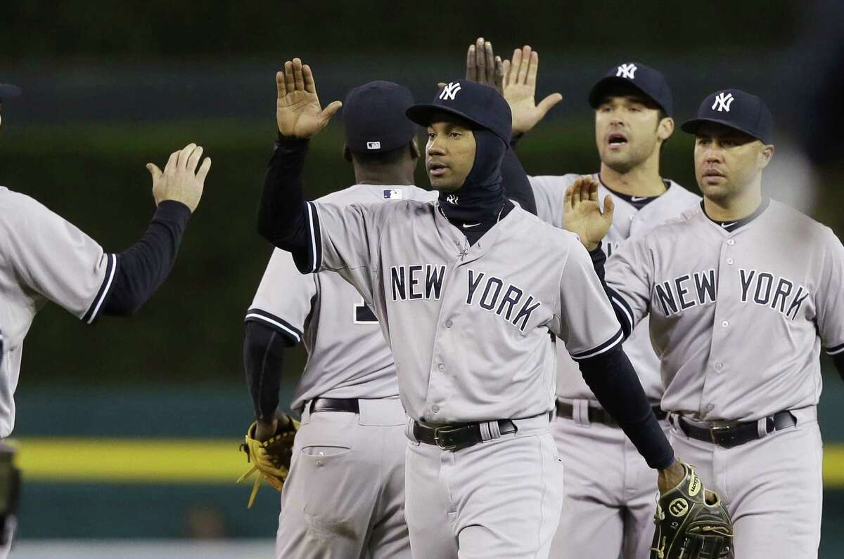 The New York Yankees celebrate their 13-4 win over the Detroit Tigers on Wednesday.