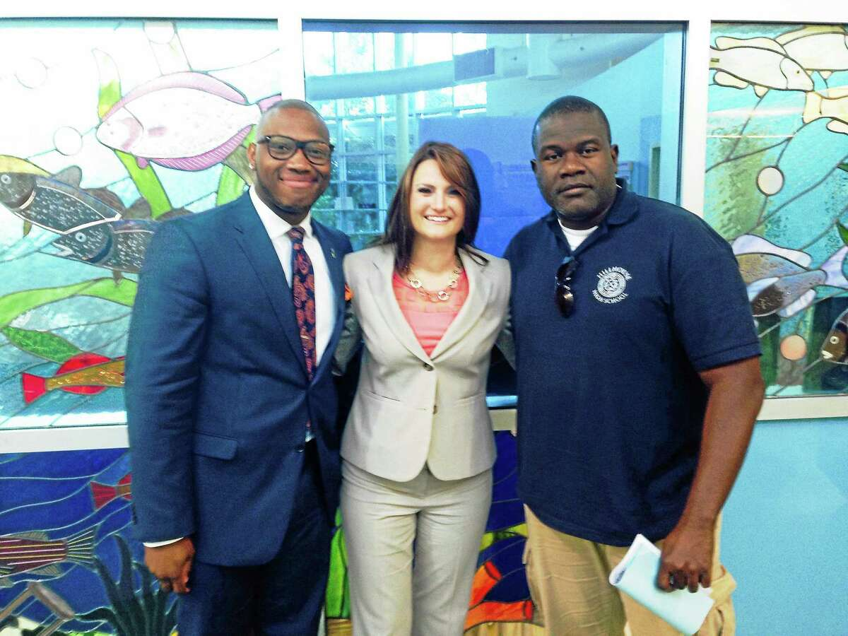 The New Haven Board of education approved three new hires Monday, from from left, Timothy Jones II, Michelle Bonora and David Diah.
