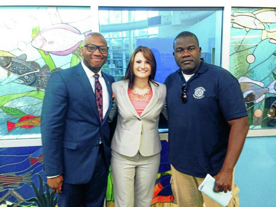 The New Haven Board of education approved three new hires Monday, from from left, Timothy Jones II, Michelle Bonora and David Diah. Photo: Ryan Flynn--New Haven Register