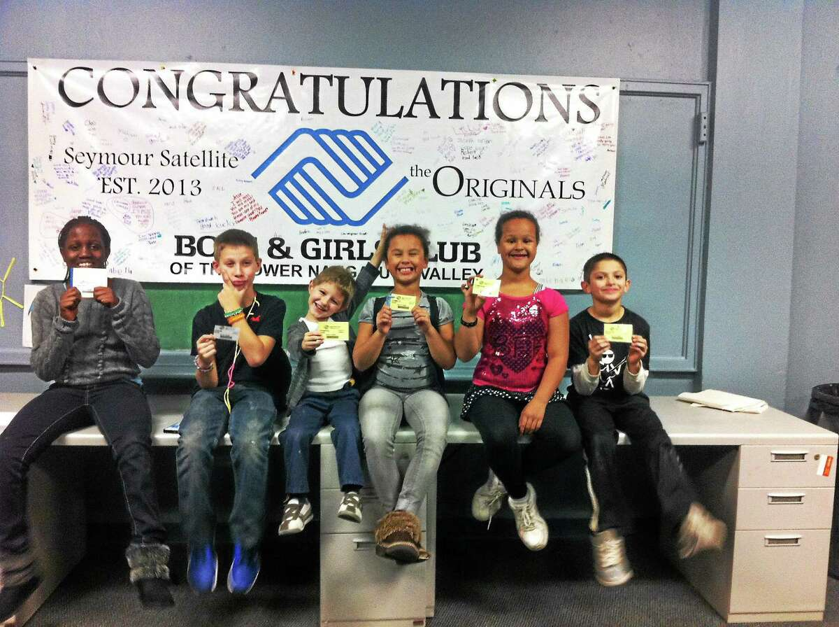 Members of the Boys & Girls Club in Seymour show off their membership cards. Contributed photo