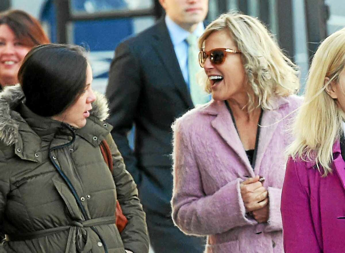 Former Congressional candidate Lisa Wilson-Foley, right, arrives at the federal courthouse in New Haven Tuesday for her sentencing in hiding a campaign-consulting relationship with former Gov. John Rowland.