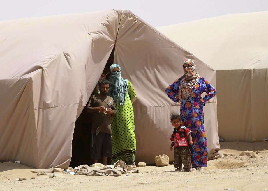 FILE - In this Friday, May 22, 2015 file photo, displaced civilians from Ramadi, Iraq, pose for a photo by their tent at a camp in the town of Amiriyat al-Fallujah, west of Baghdad. The number of people displaced within Iraq due to violence and fighting by the Islamic State group has exceeded 3 million, the United Nations said Tuesday, June 23, a grim milestone for the war-battered country. (AP Photo/Hadi Mizban, File) Photo: AP / AP