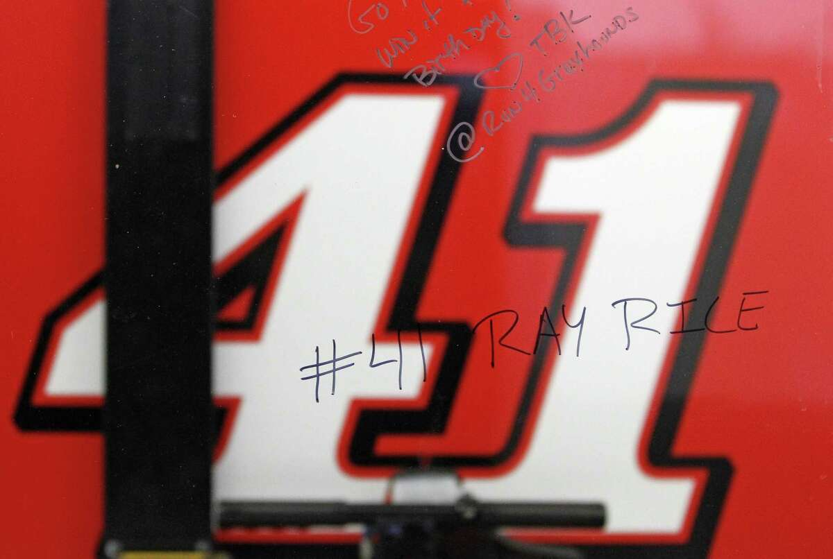 A window outside driver Kurt Busch's garage stall shows a reference to NFL player Ray Rice written by a spectator Friday at Daytona International Speedway in Daytona Beach, Fla.
