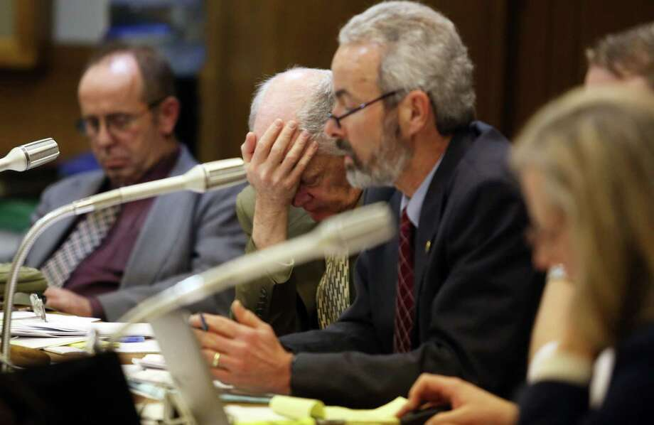 FILE--In this Feb. 6, 2014, file photo, administrative counsel Bill Taylor holds his head in his hands next to Sen. Floyd Prozanski, right, as they hear testimony at the Senate Judiciary Committee at a public gun bill hearing at the State Capitol in Salem, Ore.  With a stronger Democratic majority in the Oregon Legislature, gun safety advocates are hoping the third time will be the charm on a bill to expand the use of background checks for gun sales. (AP Photo/Kobbi R. Blair, Statesman Journal, file) Photo: AP / THE STATESMAN JOURNAL