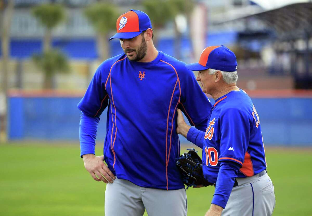 New York Mets manager Terry Collins, right, talks with pitcher Matt Harvey during spring training Saturday in Port St. Lucie, Fla.