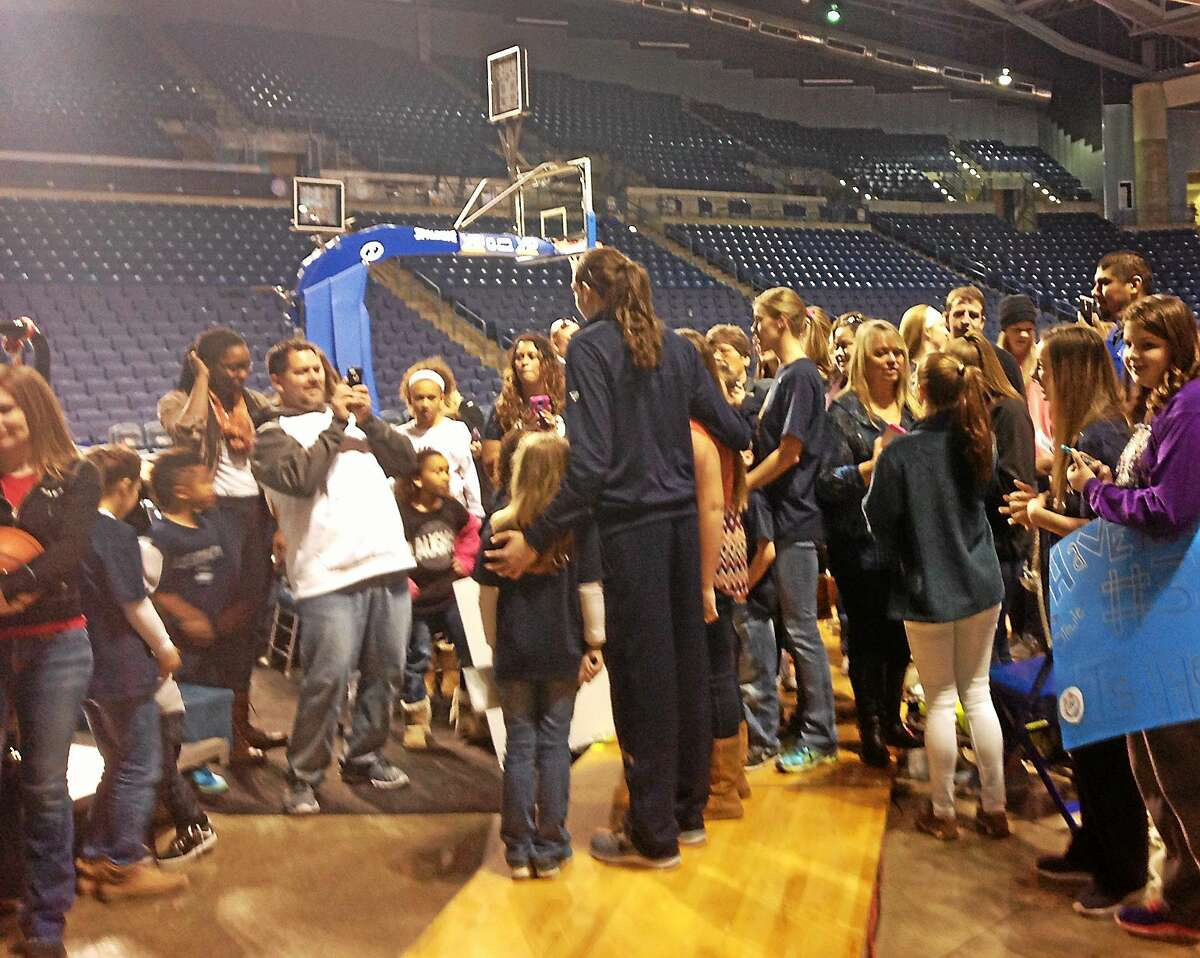 UConn forward Breanna Stewart poses for photos with fans after the top-ranked Huskies beat Tulsa 92-46 on Saturday afternoon in Oklahoma.
