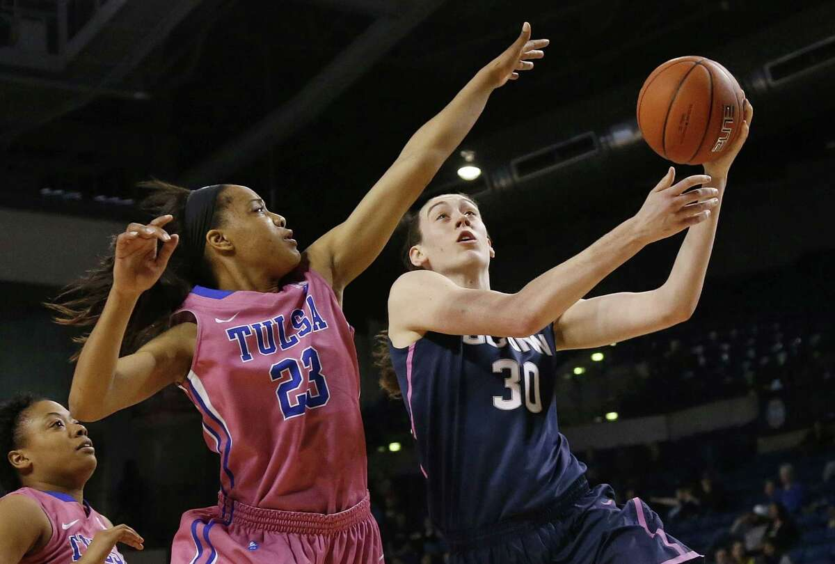 UConn forward Breanna Stewart shoots over Tulsa guard Ashley Clark (23) during the first half of the Huskies' 92-46 win on Saturday in Tulsa, Okla.