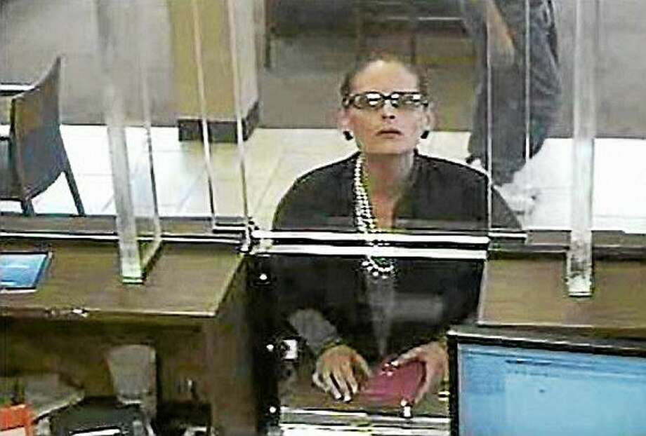 New York State Police are searching for the suspect who was caught on bank surveillance cameras on Sept. 23, 2014 at Chase bank in Commack and on Sept. 24, 2014 at Chase bank in Freeport. Photo: Screenshot Via Newsday.com./Photo Credit: New York State Police