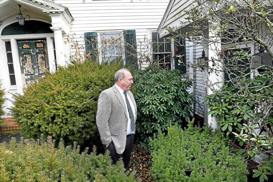 Rich Meier, chairman of the Guilford Planning and Zoning Commission, walks past the entrance to the former Sachem House restaurant at 111 Goose Lane in Guilford. Photo: Arnold Gold — New Haven Register