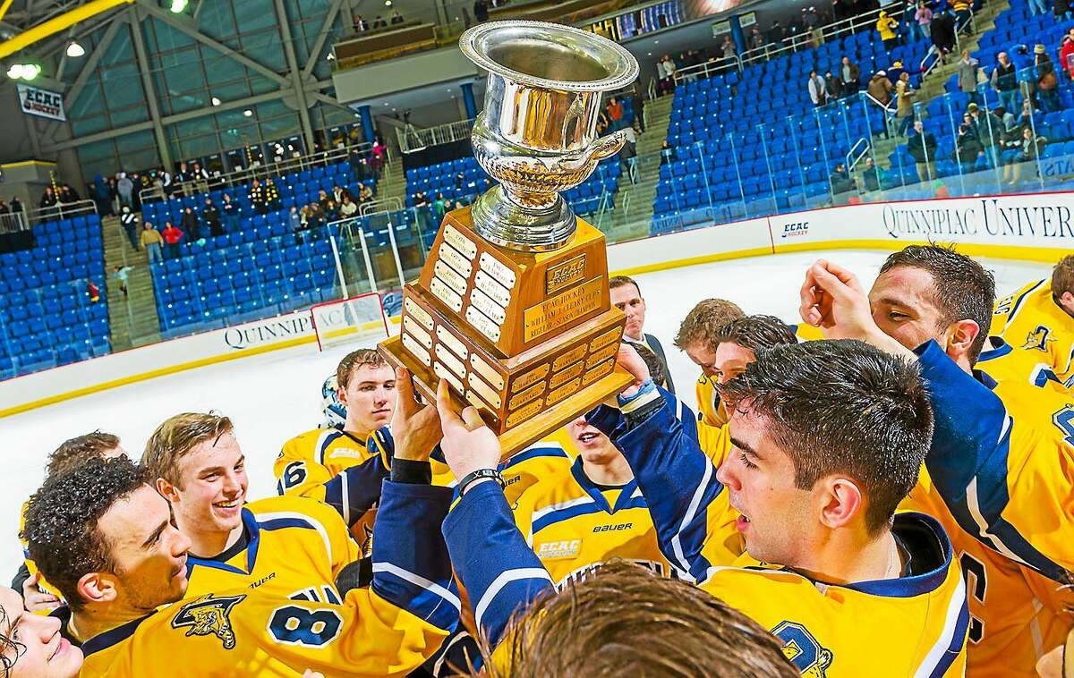Members of the Quinnipiac hockey team celebrate after clinching at least a share of the Cleary Cup, which is awarded to the ECAC Hockey regular-season champion.