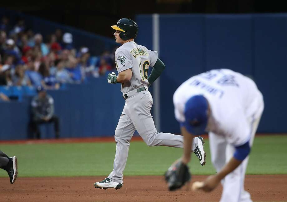 Matt Chapman of the Oakland Athletics circles the bases after hitting a solo home run in the fifth inning during MLB game action as Francisco Liriano #45 of the Toronto Blue Jays reacts at Rogers Centre on July 24, 2017 in Toronto, Canada. Photo: Tom Szczerbowski, Getty Images