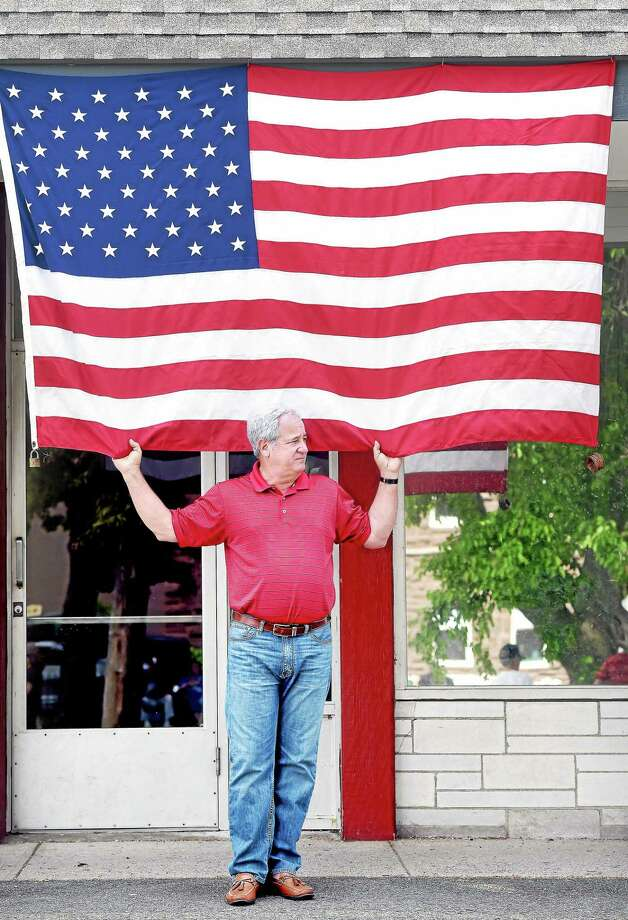 (Arnold Gold-New Haven Register)  Joe Agro of Milford watches the annual Memorial Day Parade on River St. in Milford on Sunday. Photo: Journal Register Co.