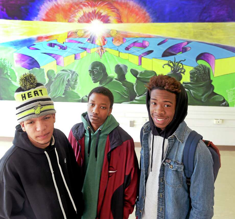 Angel Santana, 16, Shayquan Gray, 14, and Osheem McBride, 17, left to right, are three of the seven New Light School students who created a mural at the New Haven school.  Tuesday, January 20, 2015. Photo: (Peter Hvizdak — New Haven Register)   / ©2015 Peter Hvizdak