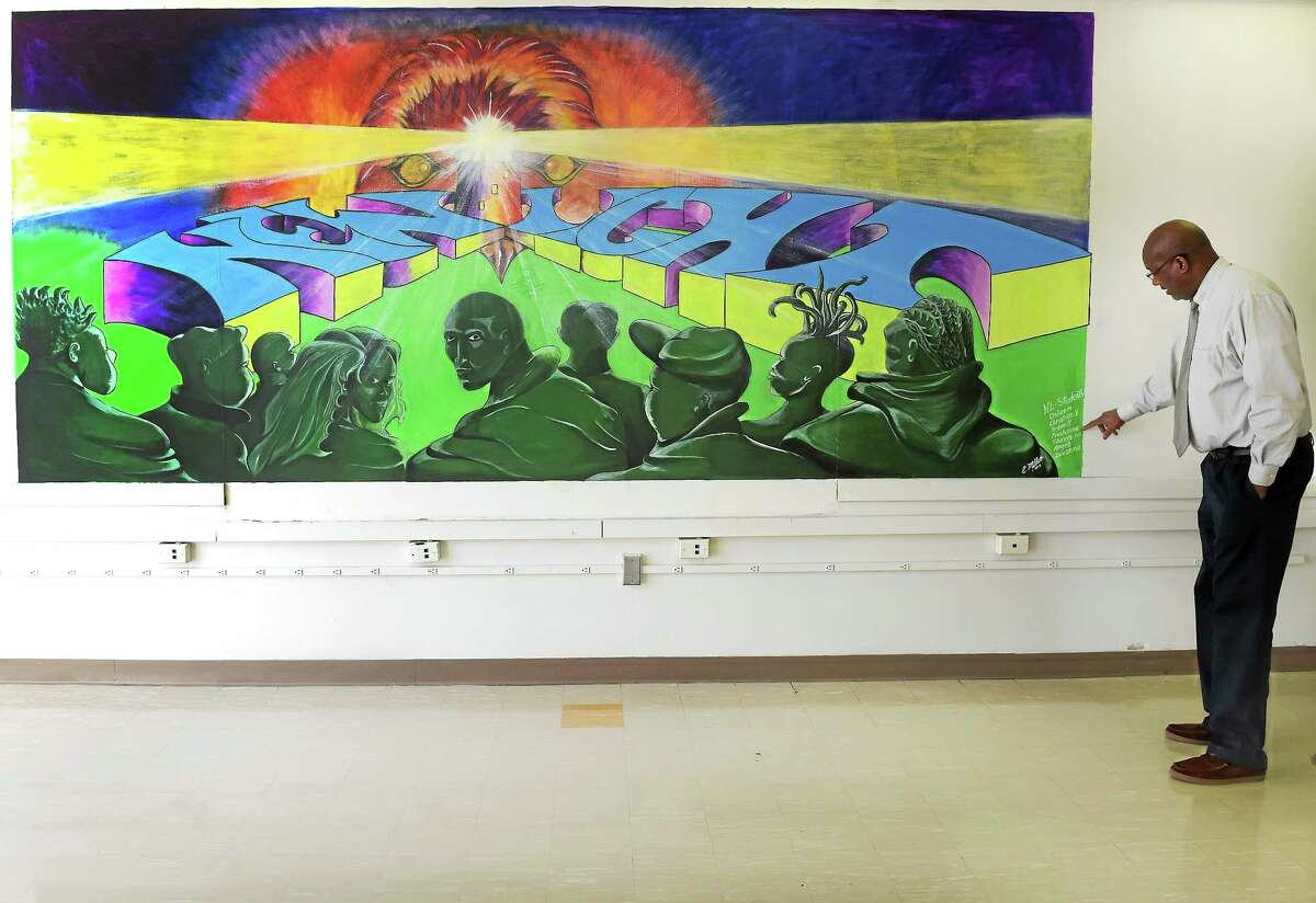 New Light School principal Larry Conaway with the school's mural, New Haven, Conn. Tuesday, January 20, 2015.