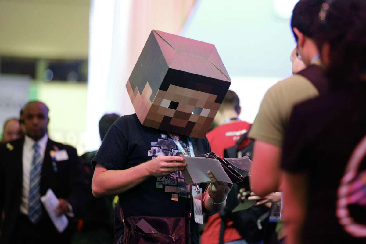 In this June 13, 2013 photo, Jonny Rice wears a Minecraft-themed mask while promoting a video clip he created during the Electronic Entertainment Expo in Los Angeles.