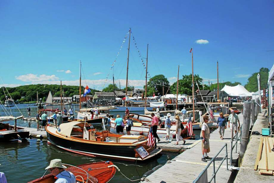 Show-goers peruse boats at the Mystic Seaport dock. Photo: Contributed