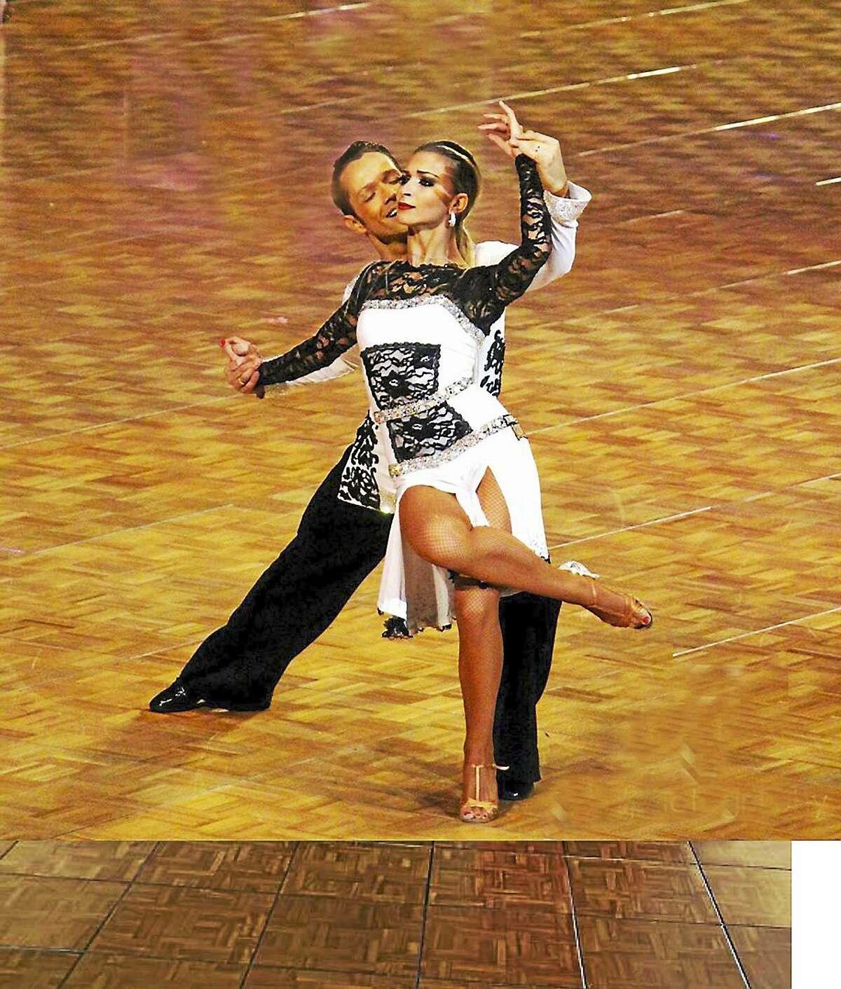 National Latin champions Pasha Pashkov and Daniella Karagach in action.