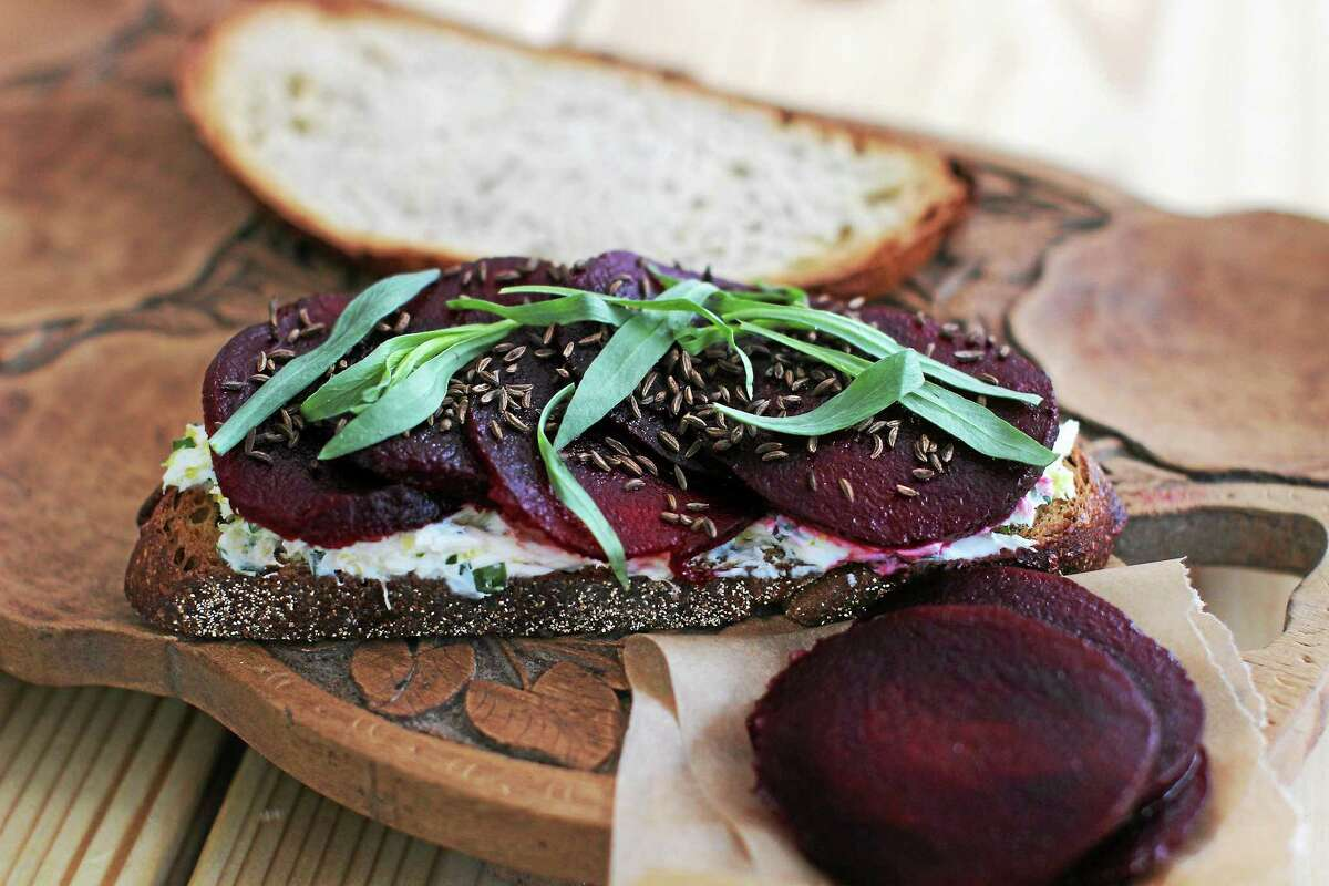 Tarragon and beets top toasted rye.
