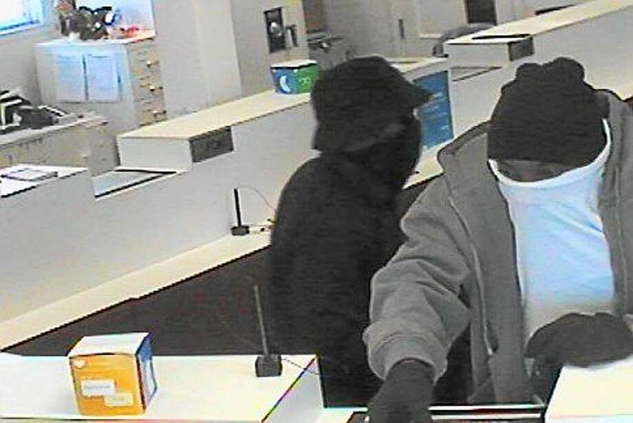 Police are searching for these two men they say robbed a Webster Bank Wednesday afternoon.   Photo courtesy of the Milford Police Department Photo: Journal Register Co.