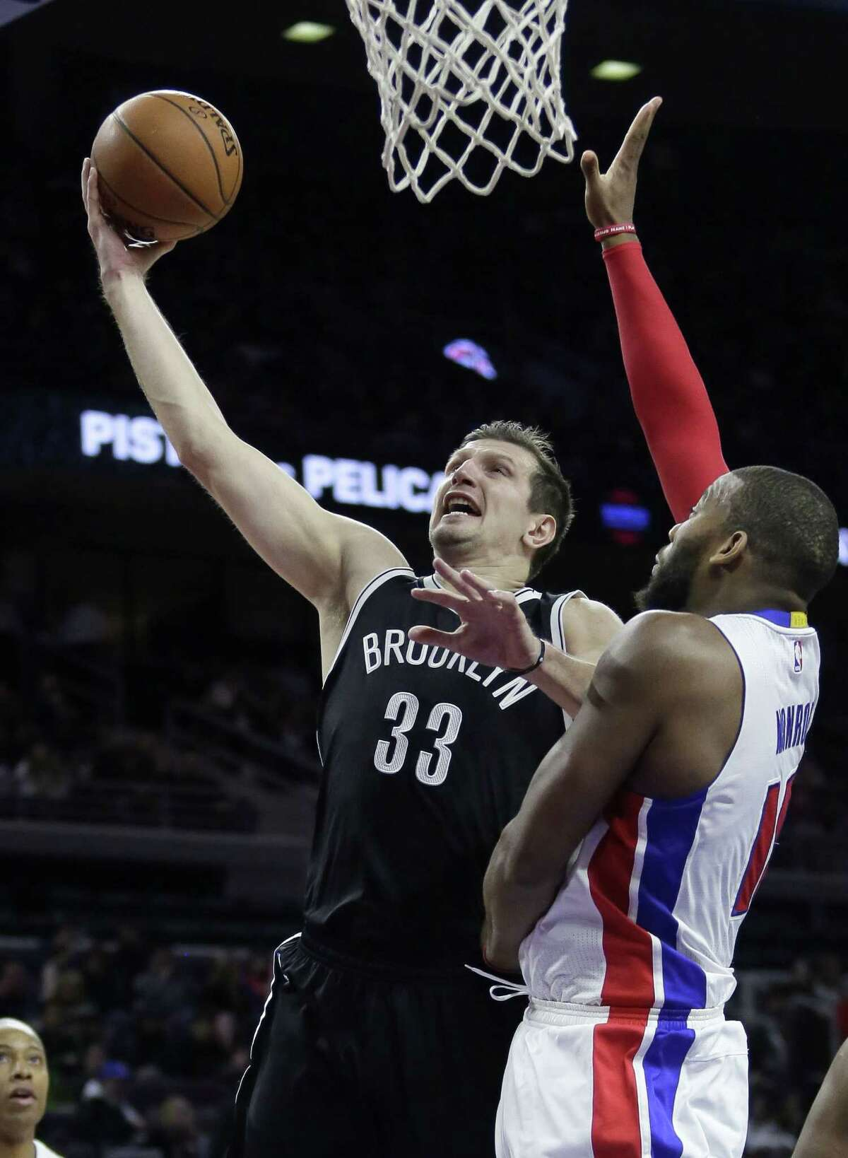 Brooklyn Nets forward Mirza Teletovic (33) goes to the basket against the Detroit Pistons' Greg Monroe during a Jan. 10 game in Auburn Hills, Mich.
