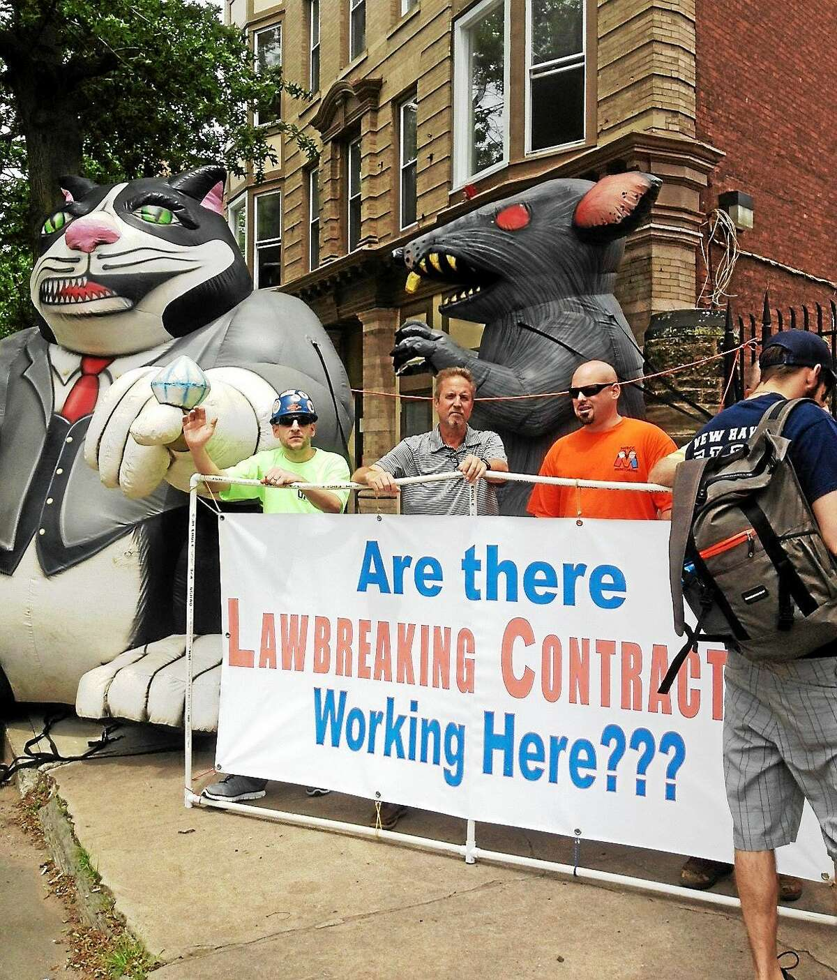 (Mary O'Leary - New Haven Register) Outside 9 Dixwell Ave. where New England Regional Council of Carpenters protested Tuesday. Ruben Hernandez Enterprises cited by labor dept for not having worker's comp and paying workers cash. Site owned by Yale Properties.